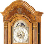 Arched Bonnet Grandfather Clocks usually are in Oak, but also are available in Cherry finishes as well.